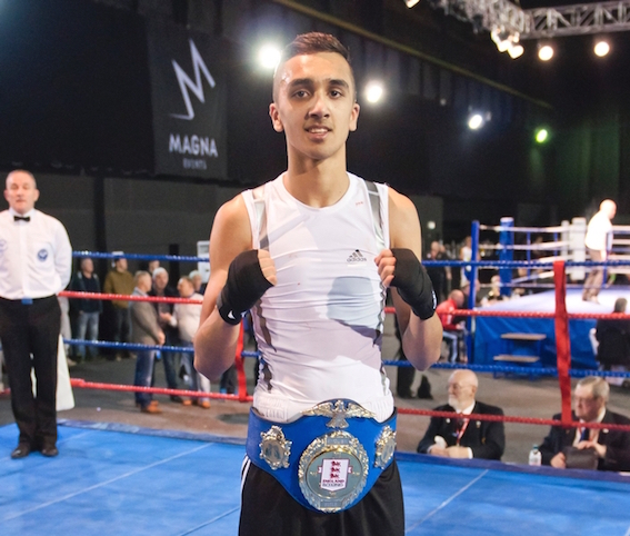 Ismail Khan with the 52kg English Title. Photograph: Sam Young