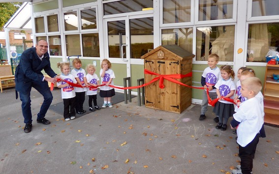 Ryan Ruscoe from Sudacrem helps children open their new Toy Shed