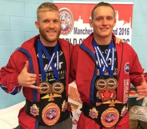 Tom (left) with his double gold