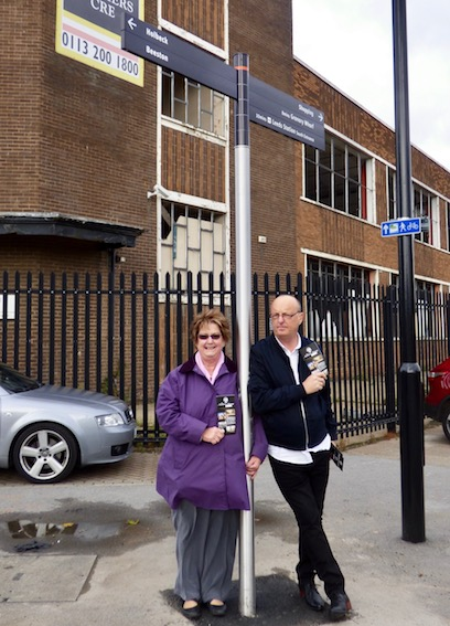 Cllr Angela Gabriel and Ian Pickup with a 'Legible Leeds' sign which replaced a heritage sign on Sweet Street