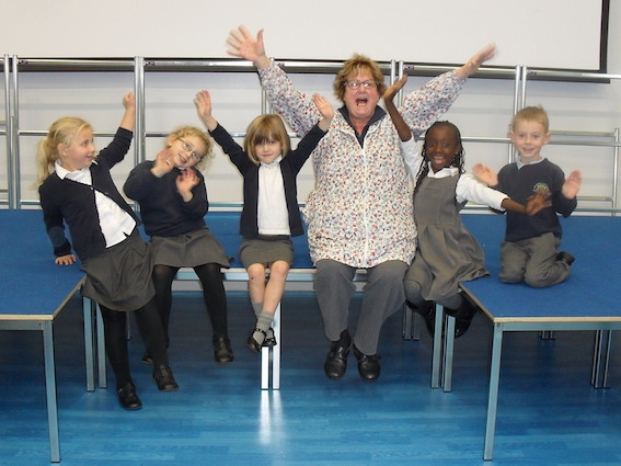 Children celebrate their new stage with Cllr Angela Gabriel